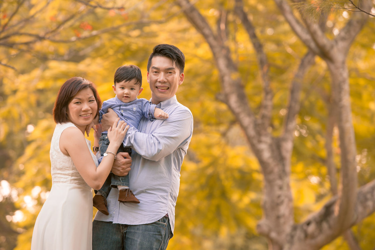 Chinese Family Affectionate ASIA Asian  Asian Family Autumn Bonding Change Chinese Daughter Family Family With Two Children Father Focus On Foreground Happiness Husband Love Men Mid Adult Mid Adult Men Nature Outdoors Smiling Son Togetherness Young Men