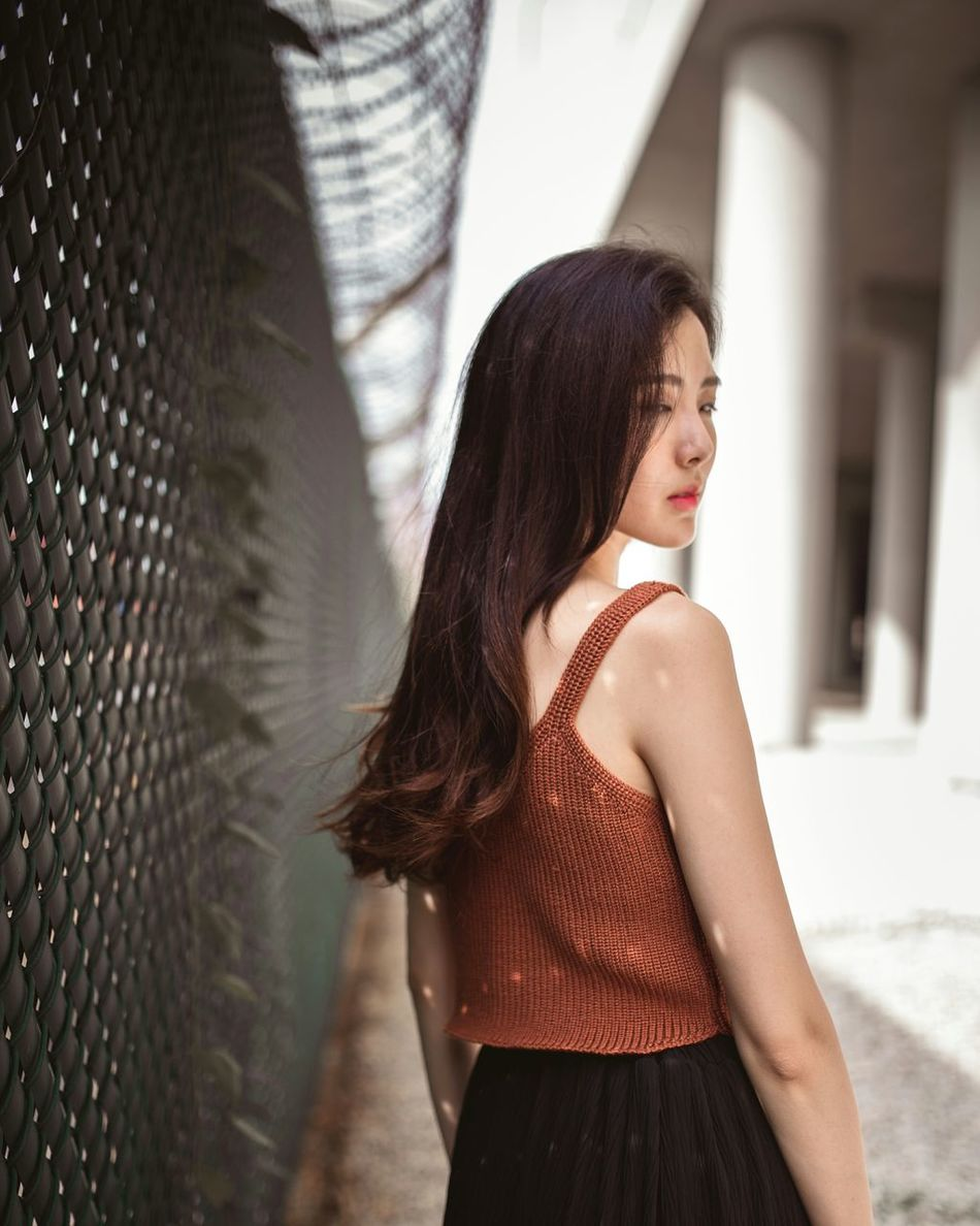 scattered light One Woman Only Outdoors Long Hair City Portrait Individuality Women Around The World The Secret Spaces TCPM Break The Mold City Cityscape City Life Urban Skyline Urban Spaces Concrete Jungle Light And Shadow Light Light Collection