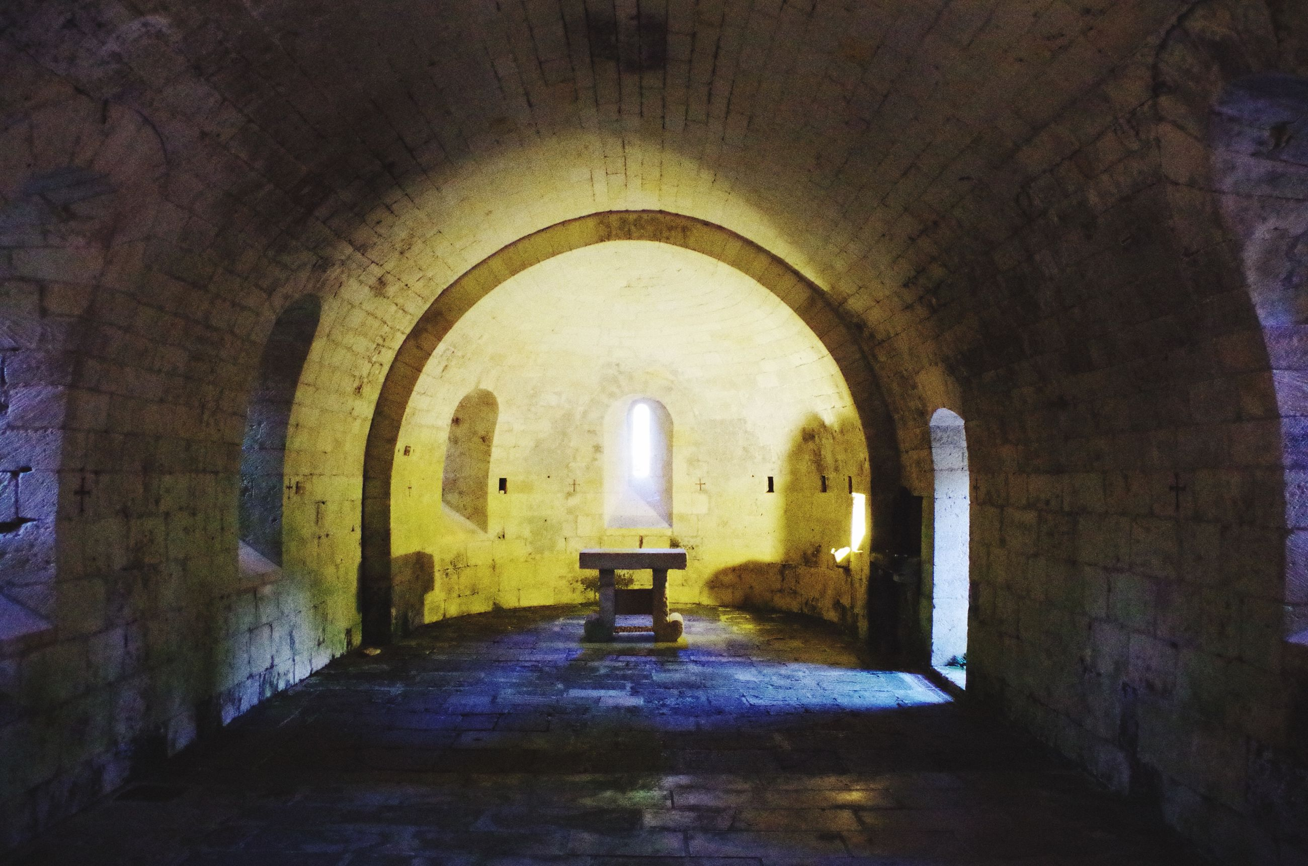 indoors, arch, architecture, built structure, the way forward, archway, tunnel, interior, ceiling, corridor, empty, old, building, narrow, wall - building feature, diminishing perspective, abandoned, illuminated, wall, absence