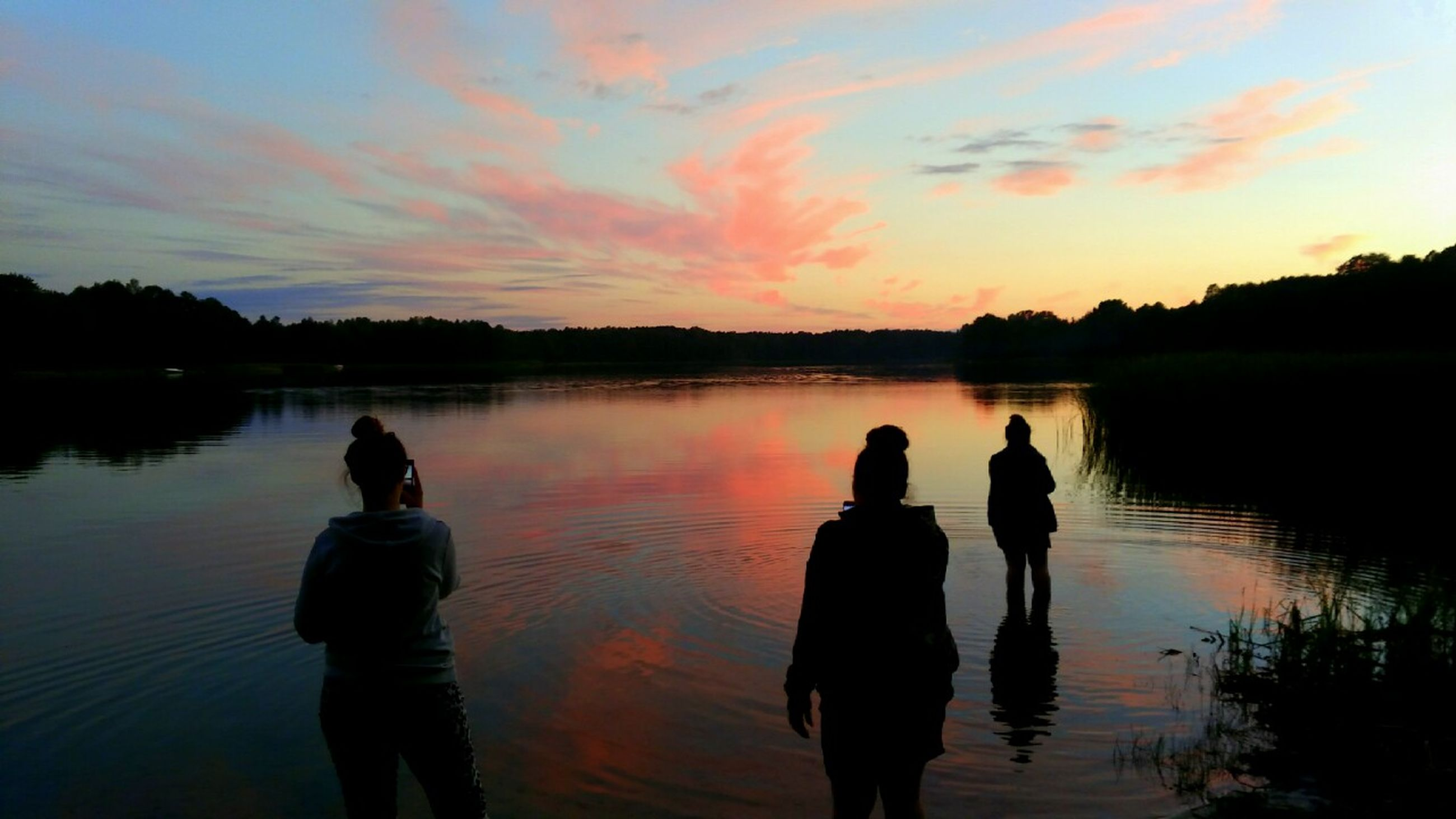 water, reflection, silhouette, sunset, sky, beauty in nature, outdoors, nature, real people, men, tranquility, lake, scenics, togetherness, tranquil scene, bonding, people, adult, day