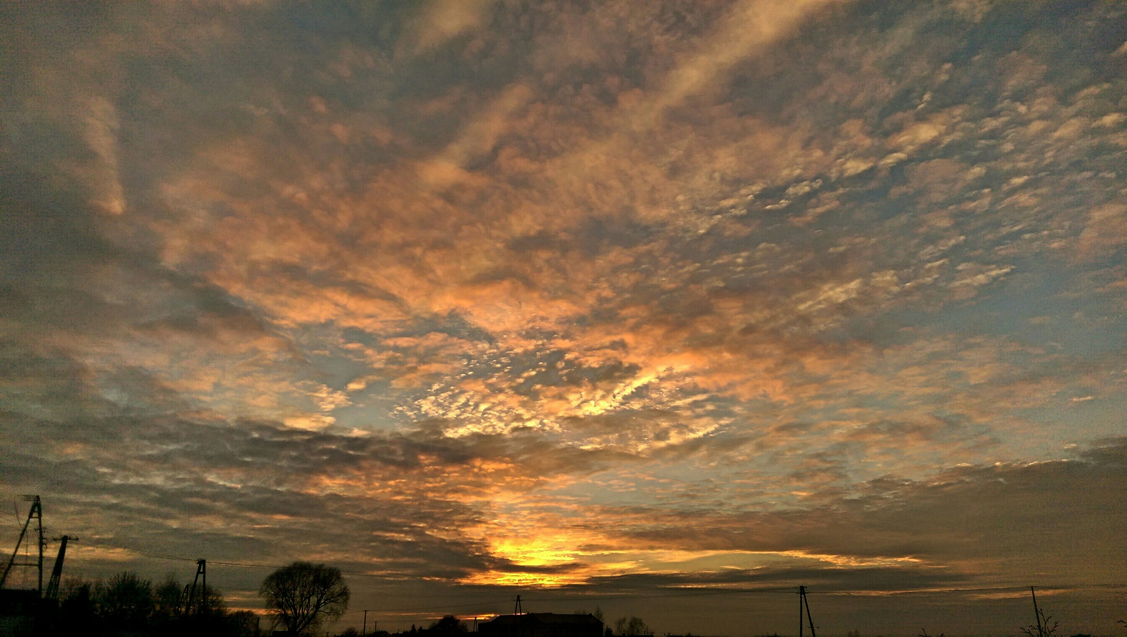 sunset, silhouette, sky, cloud - sky, beauty in nature, tranquility, scenics, low angle view, cloudy, tranquil scene, nature, dramatic sky, weather, cloud, idyllic, orange color, dusk, tree, overcast, outdoors