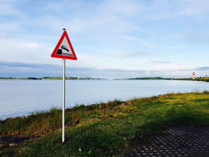 Road Sign Guidance Water Grass Warning Sign Communication Information Sign Sign Lake Landscape River Elbe Tranquility Outdoors Day Grassland Symbol Signboard Nature Blue Sky Geometric Shape EyeEmNewHere
