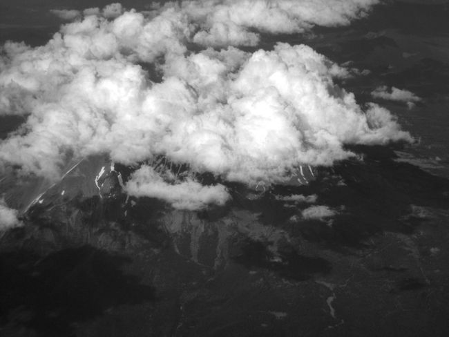 Mount Shasta surrounded in clouds from high up in an airplane. Aerial View Awe Beauty In Nature Cloud Cloud - Sky Cloudscape Day Dreamlike Environment Ethereal High Up Idyllic Majestic Mount Shasta Mountain Mountain Peak Nature Non-urban Scene Scenics Softness Tourism Tranquil Scene Tranquility White White Color