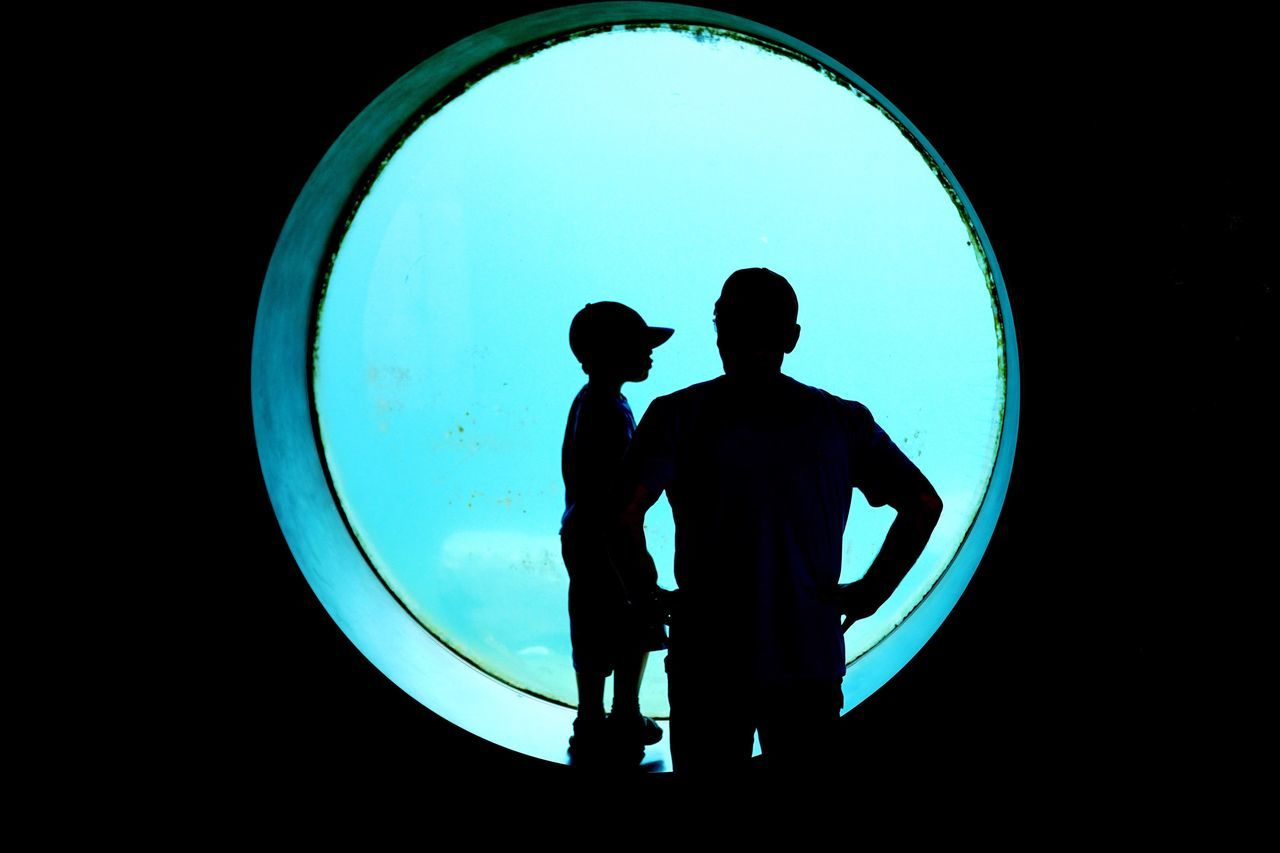 Blue Aquarium Photography Aquarium Life Discover  Fatherhood Moments Father & Son Silhouette Real People Two People Standing Togetherness Window Real Photography Family Looking To The Other Side Childhood Rear View Indoors  Blue Sea Water Ocean View