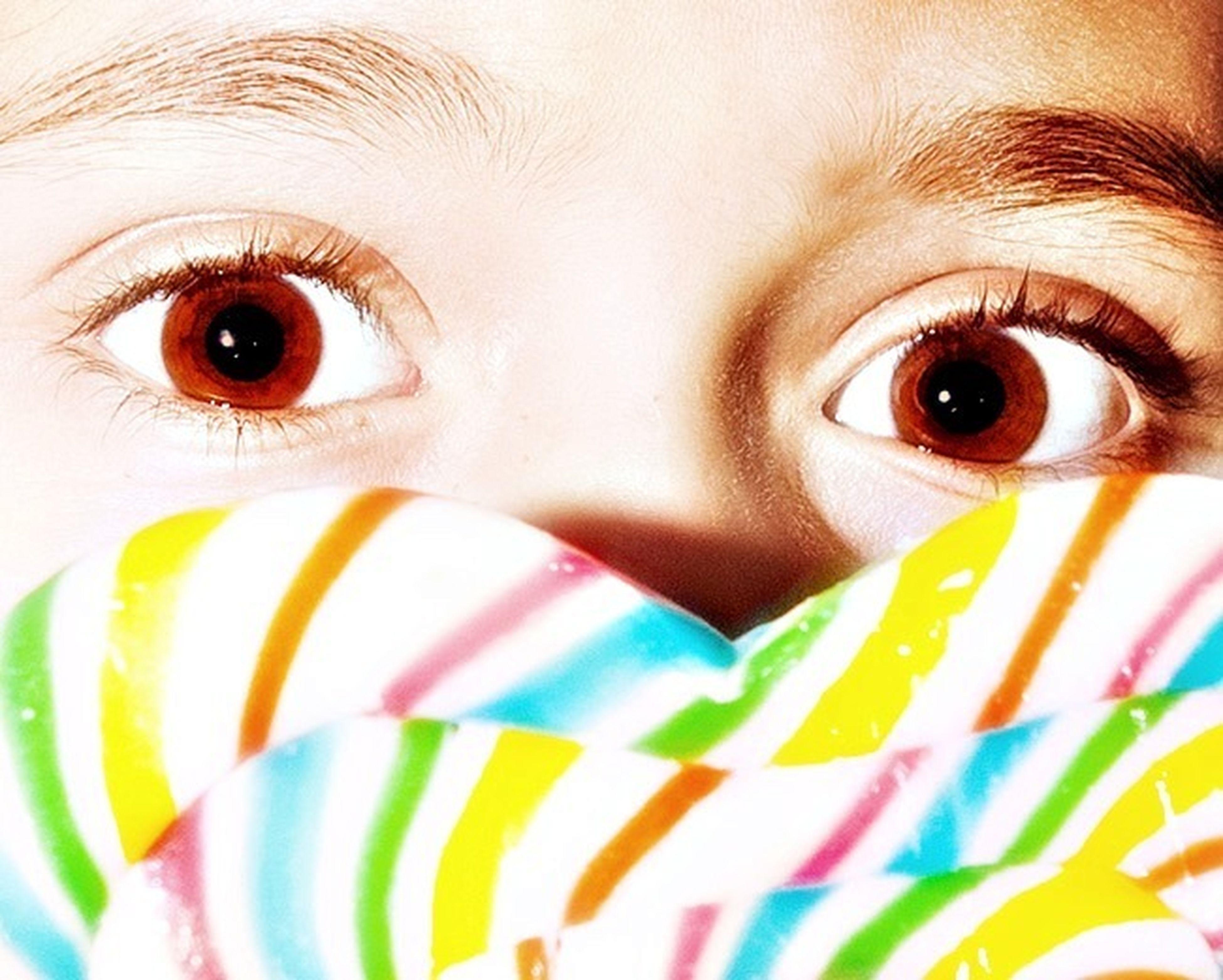 close-up, looking at camera, portrait, indoors, full frame, human eye, multi colored, backgrounds, childhood, detail, part of, cute, eyesight, eye, innocence, extreme close-up, eyelash