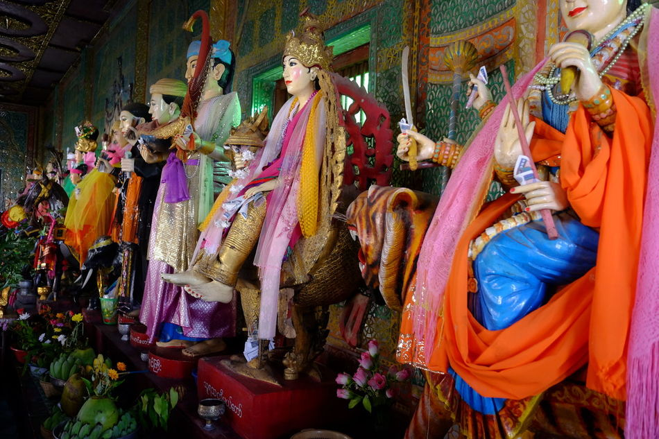 Row of 37 Buddhist Deities (known as Nats), Mount Popa Town Animal Representation Bagan Buddhism Buddhist Culture Buddhist Deities Buddhist Nats Colourful Composition Full Frame Human Representations Indoor Photography Mount Popa Multi Coloured Myanmar Nats No People Place Of Worship Side By Side Statues Tourist Attraction  Tourist Destination Traditional Clothing Traditional Costumes Unusual