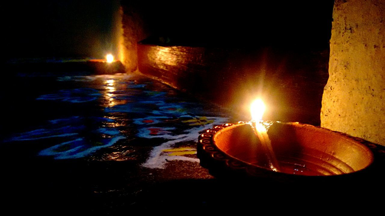 flame, burning, illuminated, heat - temperature, glowing, night, candle, diya - oil lamp, no people, indoors, diwali, melting, oil lamp, water, close-up