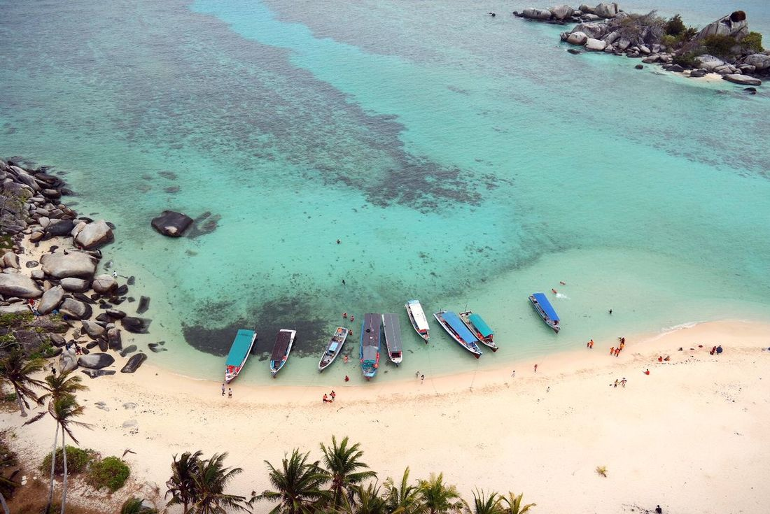 High Angle ViewBelitongisland Indonesia,Sumatra Water Outdoors Day Nature Tree Beach Vacations Nautical Vessel Sand Sea Real People Beauty In Nature Sky Large Group Of People Men People