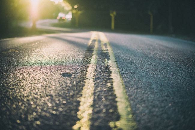 Asphalt Close-up Diminishing Perspective Empty Empty Road Focus On Foreground Long Night No People Outdoors Road Road Marking Selective Focus Street Sunlight Surface Level The Way Forward Transportation Vanishing Point