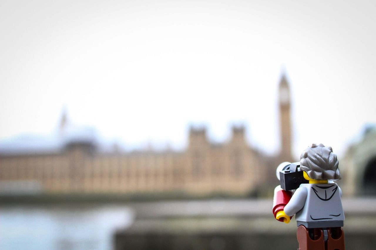 Focus On Foreground Close-up Outdoors Building Exterior Helmet Headwear Architecture Real People Day Sky Cityscape Houses Of Parliament Big Ben River Thames LEGO Lego Minifigures Photographer Self Portrait London London Lifestyle Places Of Interest No People