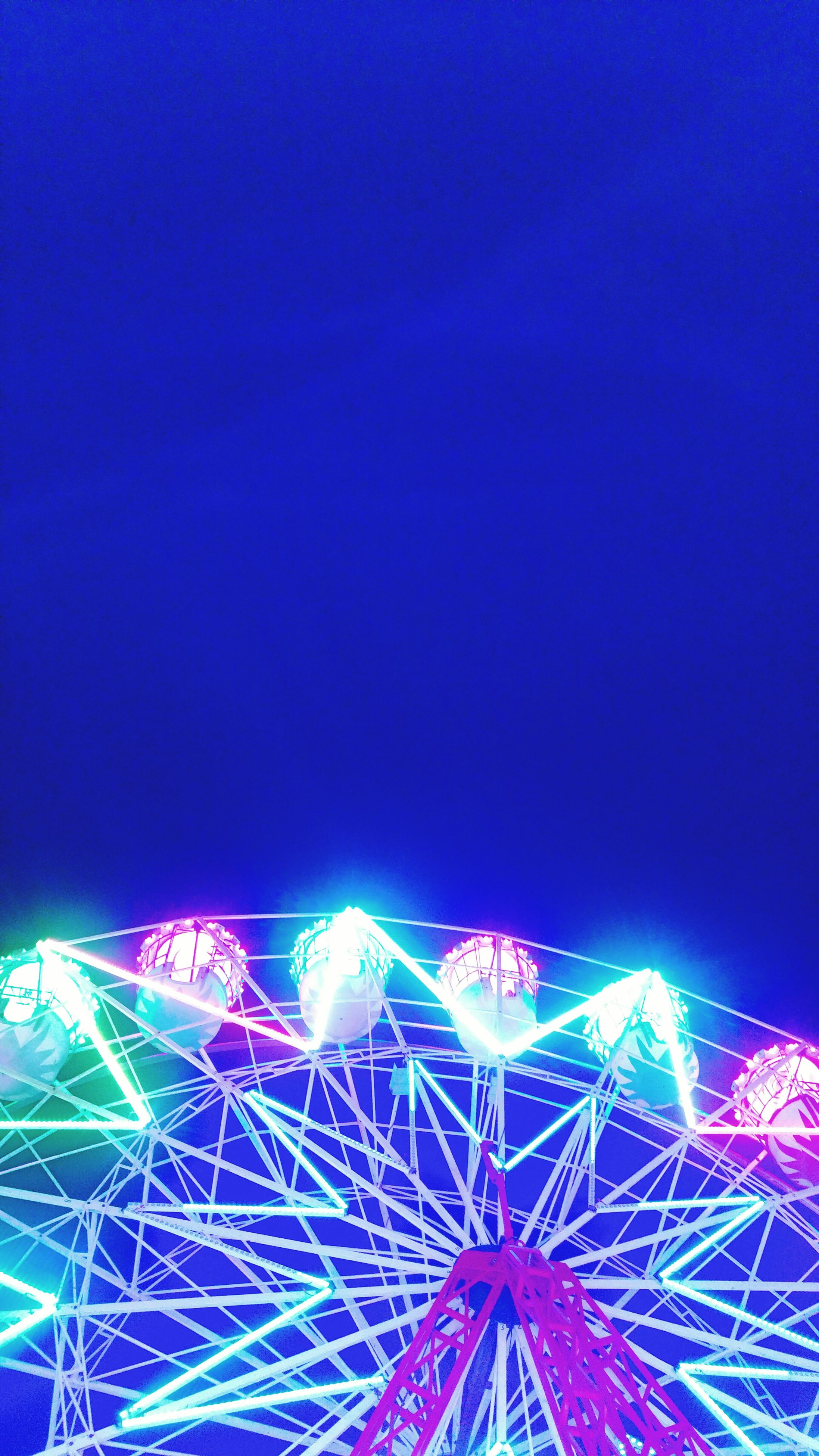 illuminated, night, blue, multi colored, low angle view, glowing, outdoors, light trail, sky, no people, travel destinations, abstract, light, tourism