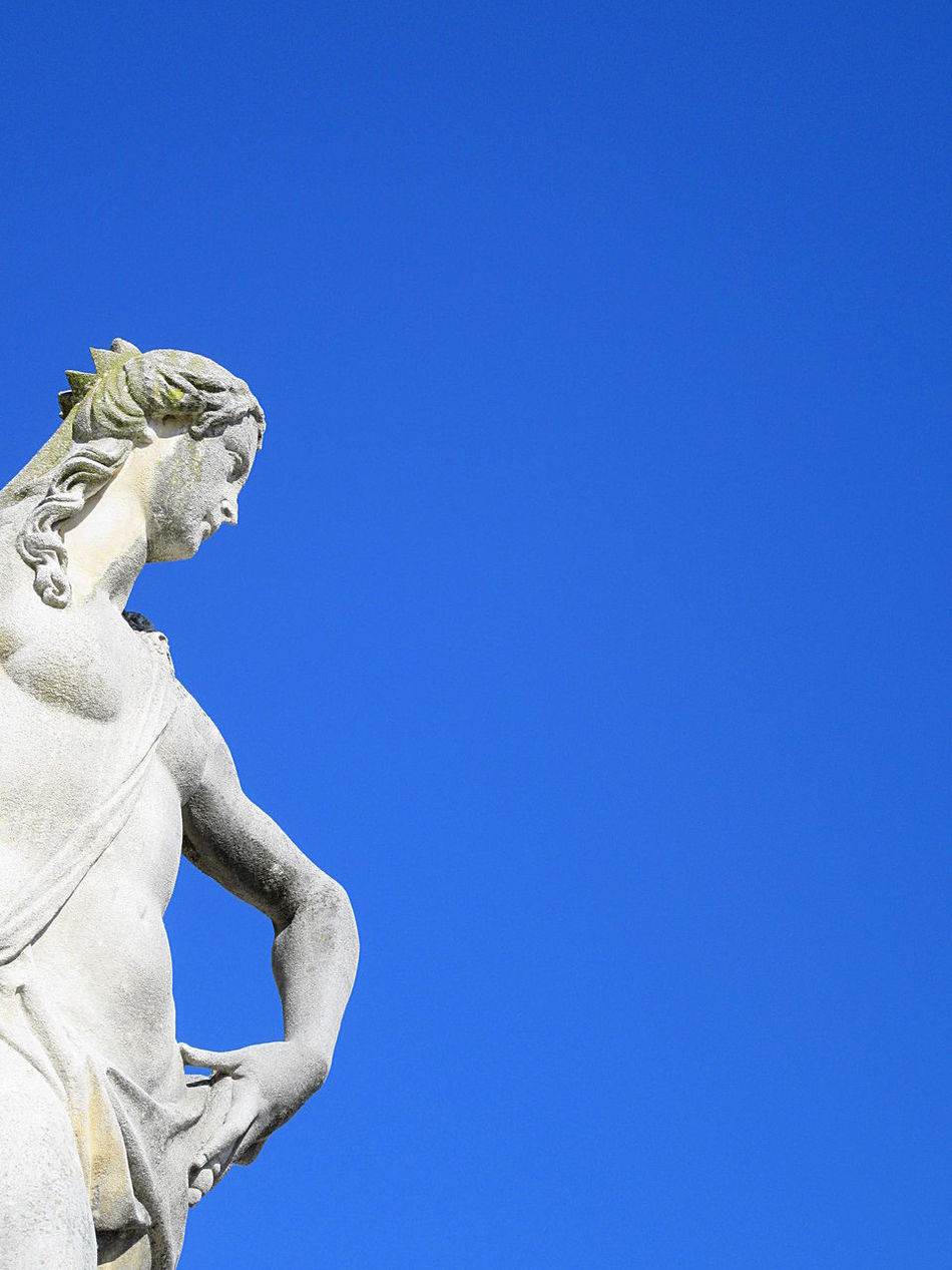 White marble woman statue over clear blue sky Art And Craft Blue Clear Sky Close-up Copy Space Copy Space Day Human Representation Low Angle View Marble No People Outdoors Religion Sculpted Sculpture Statue White Woman