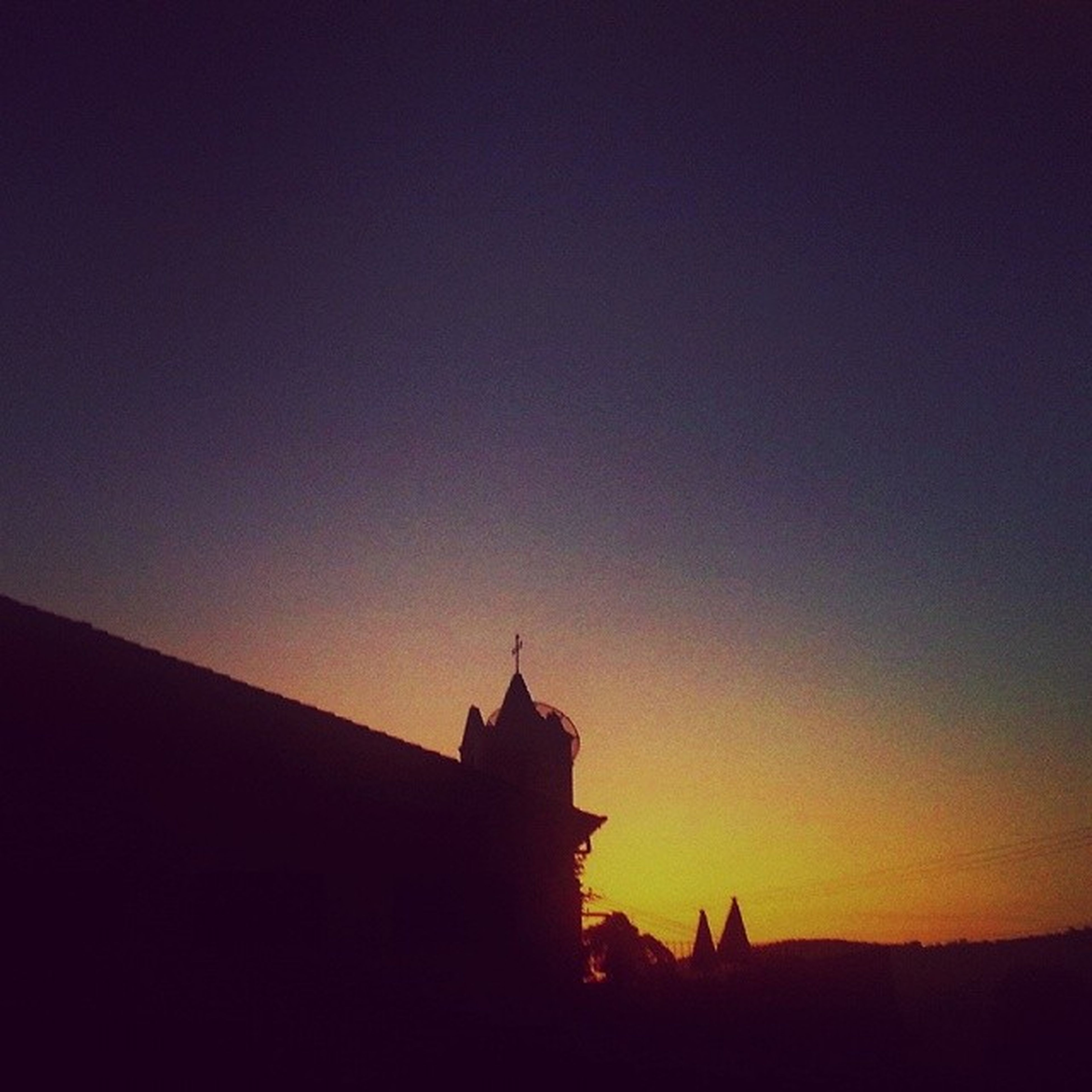 silhouette, architecture, building exterior, built structure, sunset, copy space, clear sky, religion, place of worship, dusk, church, sky, spirituality, low angle view, orange color, outdoors, house, nature, beauty in nature