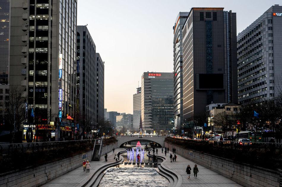 Cheonggyechon Stream, Seoul, Korea Architecture Cheonggye Cheonggyecheon City Cityscape Green Korea Leisure Activity Metropolitan Open Space Public Restoration River Seoul Skyscraper Stream Street Sunset Urban Urban Planning Walking