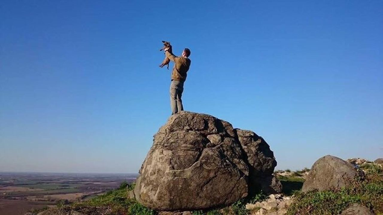 Rock - Object One Man Only Arms Raised Full Length Standing One Person Blue Only Men Outdoors Adult Nature Adults Only Landscape Men Sky Human Body Part People Day Clear Sky Mountain Dog Lionking