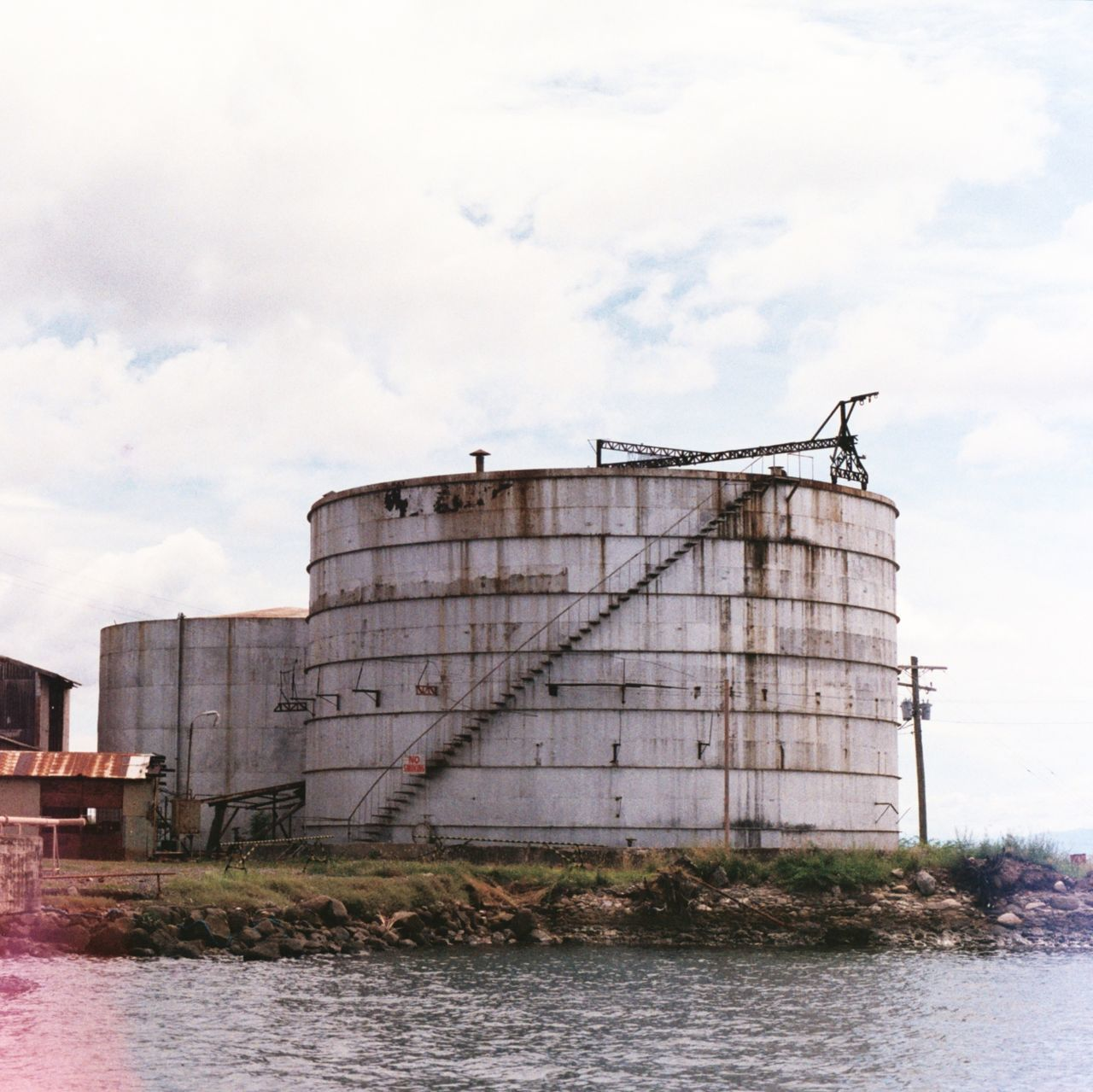 Abandoned oil depot. Bais Negros Oriental Philippines Oil Depot Oil Depot Built Structure Cloud - Sky Architecture Film Photography 35mm Film Photography Travel Destinations Unedited Unfiltered Olympus Olympus OM-1