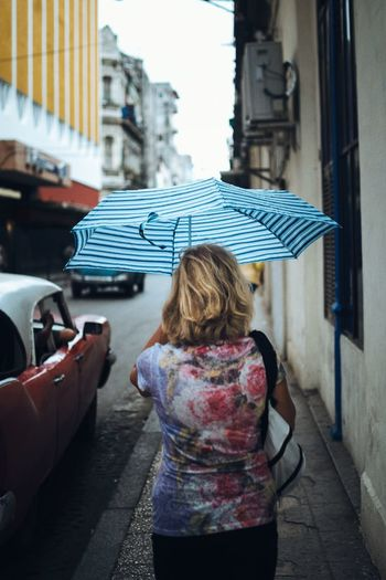 Llovizna y estampado One Young Woman Only Umbrella Architecture Streetphotography One Person Street Only Women City City Street One Woman Only Building Exterior Rear View Built Structure Adults Only People Day Adult Outdoors Young Adult Blond Hair Havana, Cuba