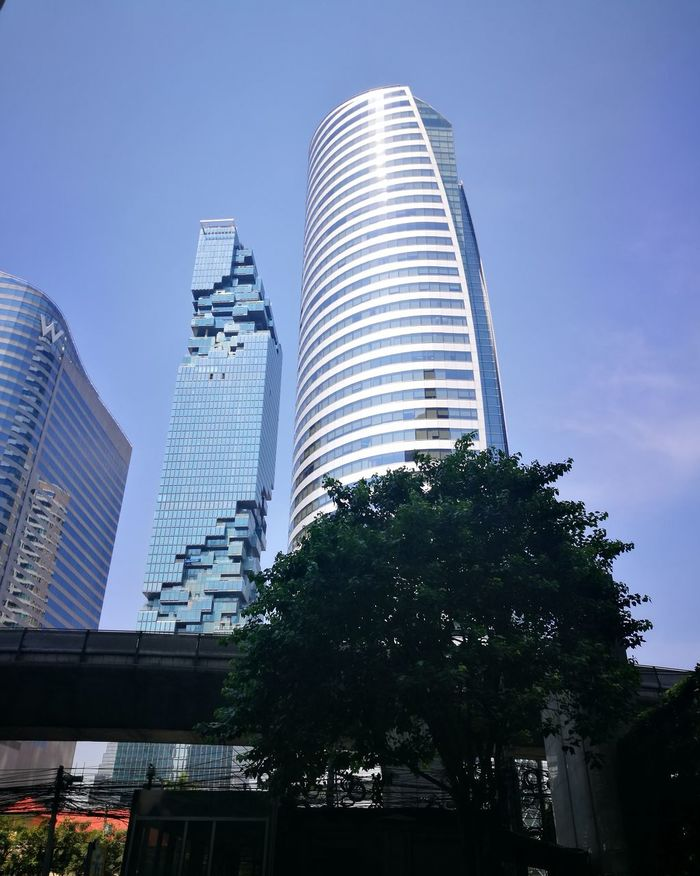 Tower Architecture City Skyscraper Modern Sky Building Exterior Low Angle View Tree Outdoors Thailand Building Buildings Taken By Huawei P9 Downtown District Cityscape City Life City Street Towers Towers And Sky Towers View Urban Skyline No People Bangkok Thailand.