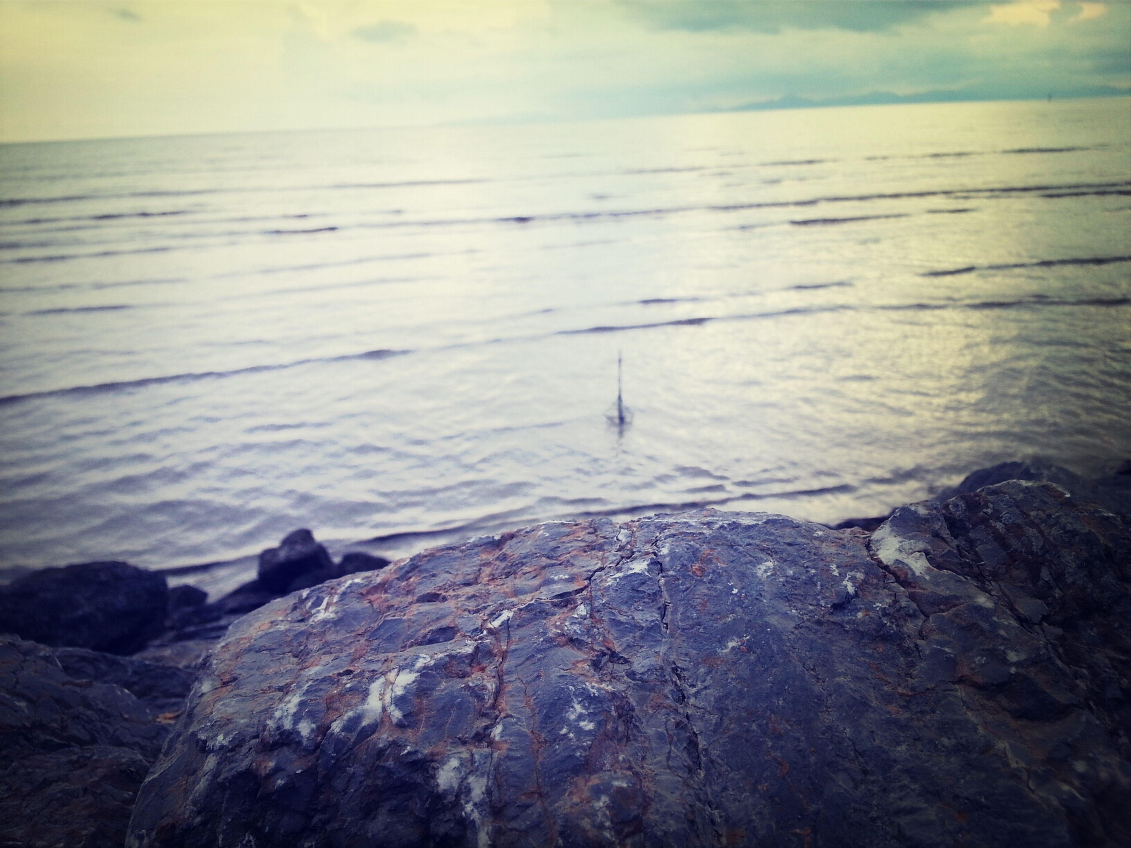 water, sea, tranquil scene, tranquility, scenics, beauty in nature, rock - object, sky, nature, horizon over water, sunset, idyllic, rock, shore, cloud - sky, outdoors, remote, non-urban scene, reflection, dusk