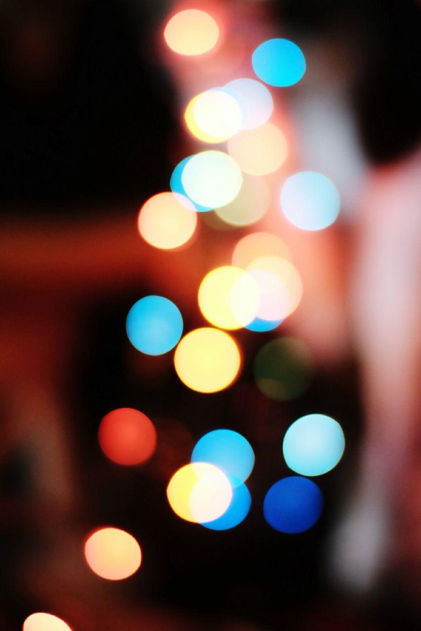 night, illuminated, defocused, christmas, celebration, focus on foreground, multi colored, no people, close-up, light effect, christmas decoration, outdoors