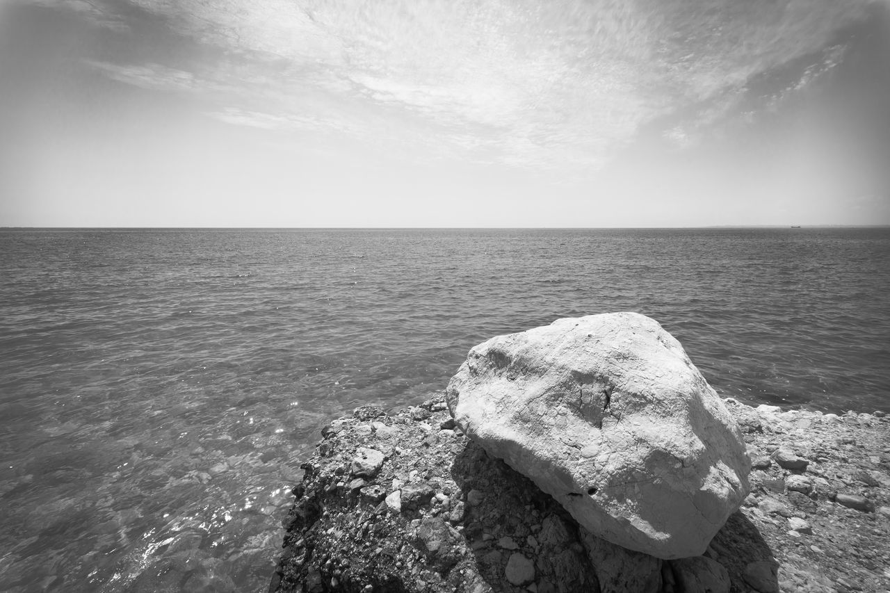 A big weathering white rock overseeing dark sea and sky. Aegean Artistic Attraction Black Black And White Clouds Conditions Dark Destination Envrionment Nature Rock Sea Seascape Sky Stone Traveling Turkey Water Weathering