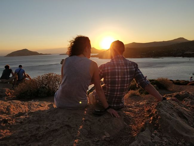 A couple watching the sunset in Sounio. Sunset Huaweiphotography Travelling Traveler Oneplus Greece Sounio Love Love ♥ Adult Togetherness Sunset Adults Only People Two People Heterosexual Couple Women Men Bonding Vacations Couple - Relationship Outdoors Sitting Friendship Sea