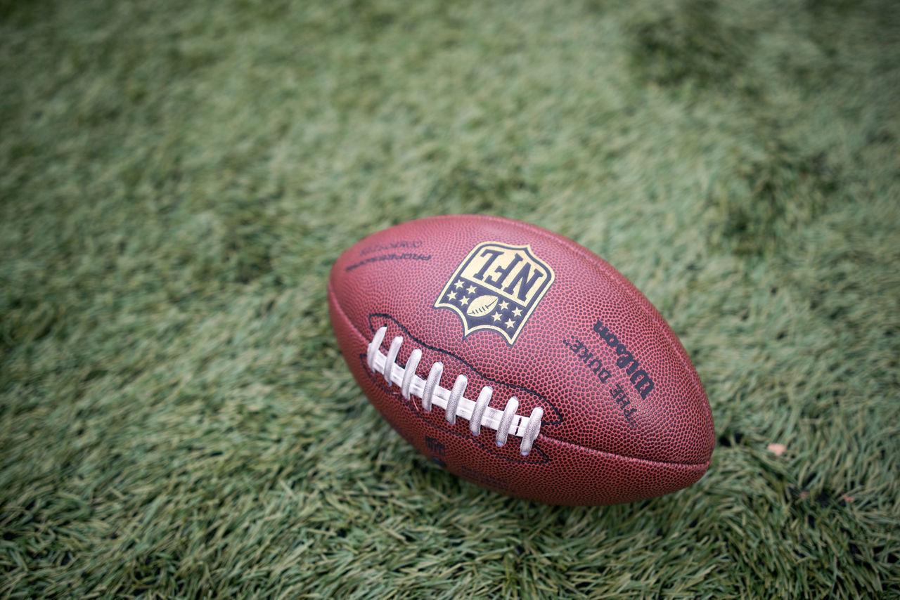 American Football - Ball American Football - Sport American Football Field Badge Ball Close-up Day Grass NFL No People Outdoors Sport Wilson