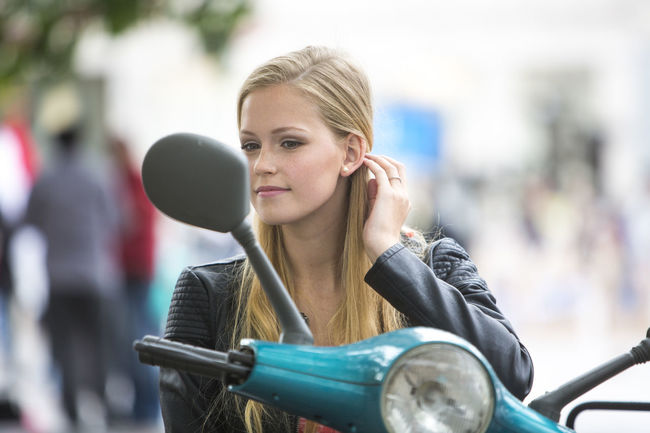 Woman Portrait Transportation Scooter Vespa Young Woman Female Moped Transport Blond Hair Real People One Person Attractive Pretty Girl Outdoors Portrait Of A Woman Young Women Beautiful People Cute Young Adult Beauty Copy Space Looking In The Mirror Rear Mirror Driving Mirror Portrait