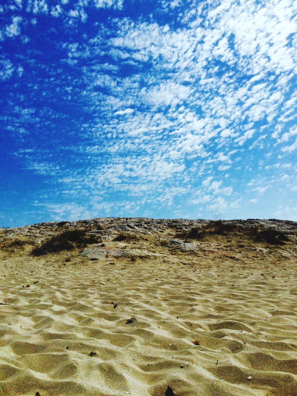 sand, sky, nature, beauty in nature, no people, tranquility, day, scenics, outdoors, landscape, beach, tranquil scene, blue, cloud - sky, sand dune, desert, water