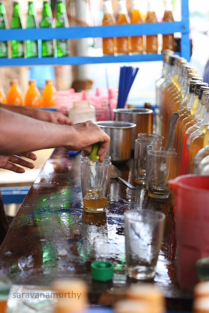 human hand, human body part, drink, food and drink, indoors, real people, refreshment, one person, alcohol, drinking glass, shelf, men, occupation, food, freshness, day, close-up, people