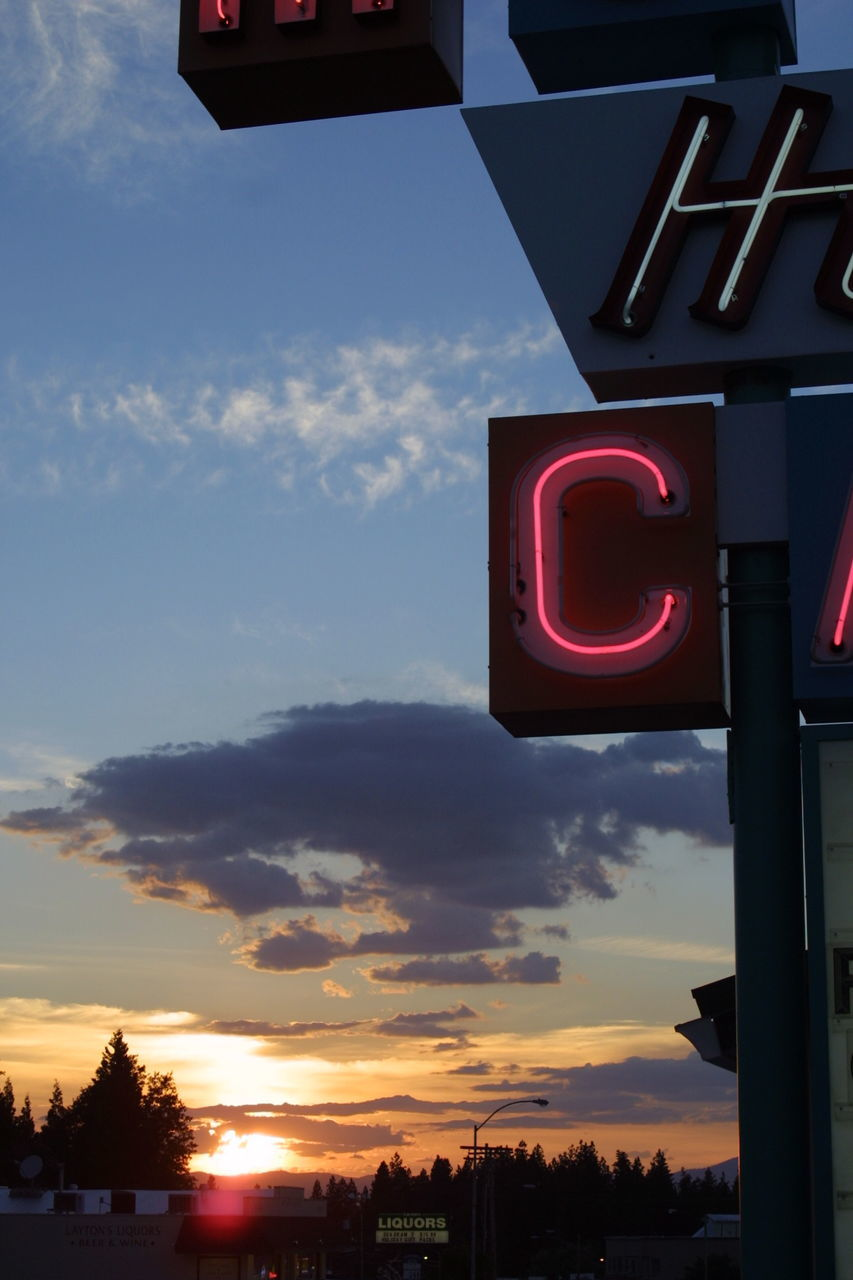 View of neon against sunset sky