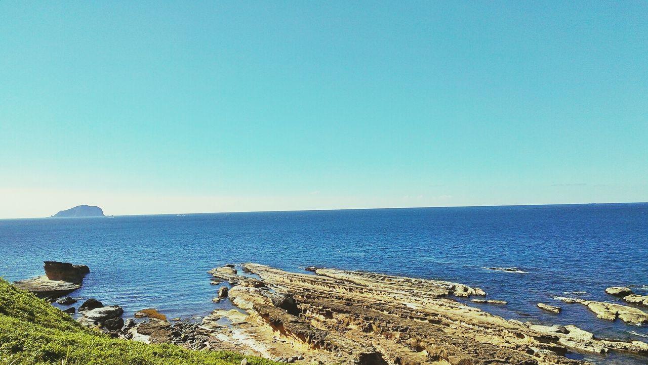 Scenic Shot Of Beach With Calm Blue Sea