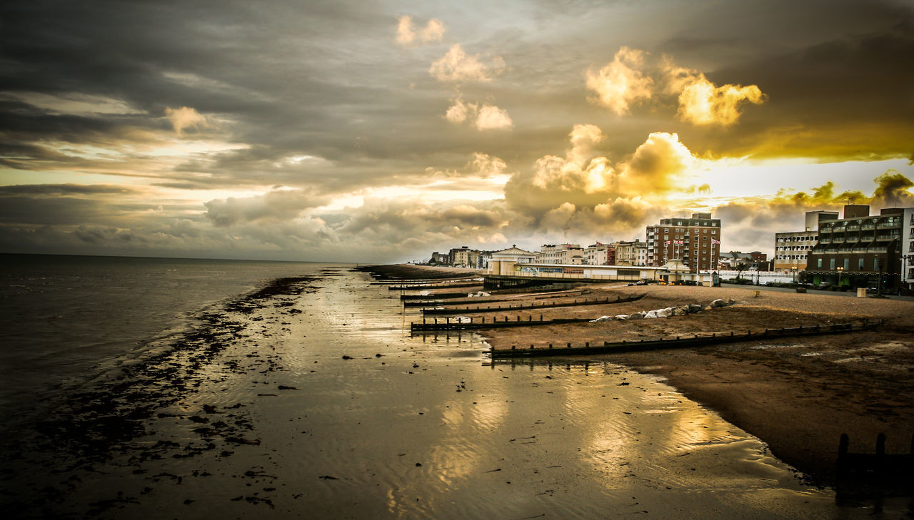sky, cloud - sky, sea, water, architecture, built structure, sunset, outdoors, building exterior, beauty in nature, nature, no people, beach, scenics, tranquility, horizon over water, city, day