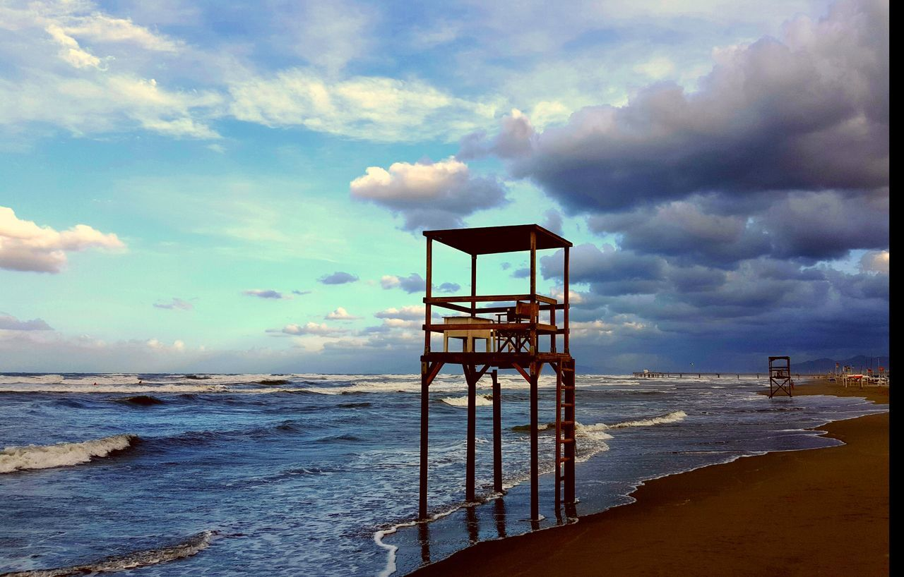Beach Lifeguard Hut Cloud - Sky Safety Built Structure Lifeguard  Sand Sea No People EyeEmNewHere Beach Photography Eyem Collection The Week On EyeEm Libecciata Red Danger Zone Sunset Nature Investing In Quality Of Life Spiaggia🐚 Feel The Journey Tranquility Horizon Over Water Sky Water