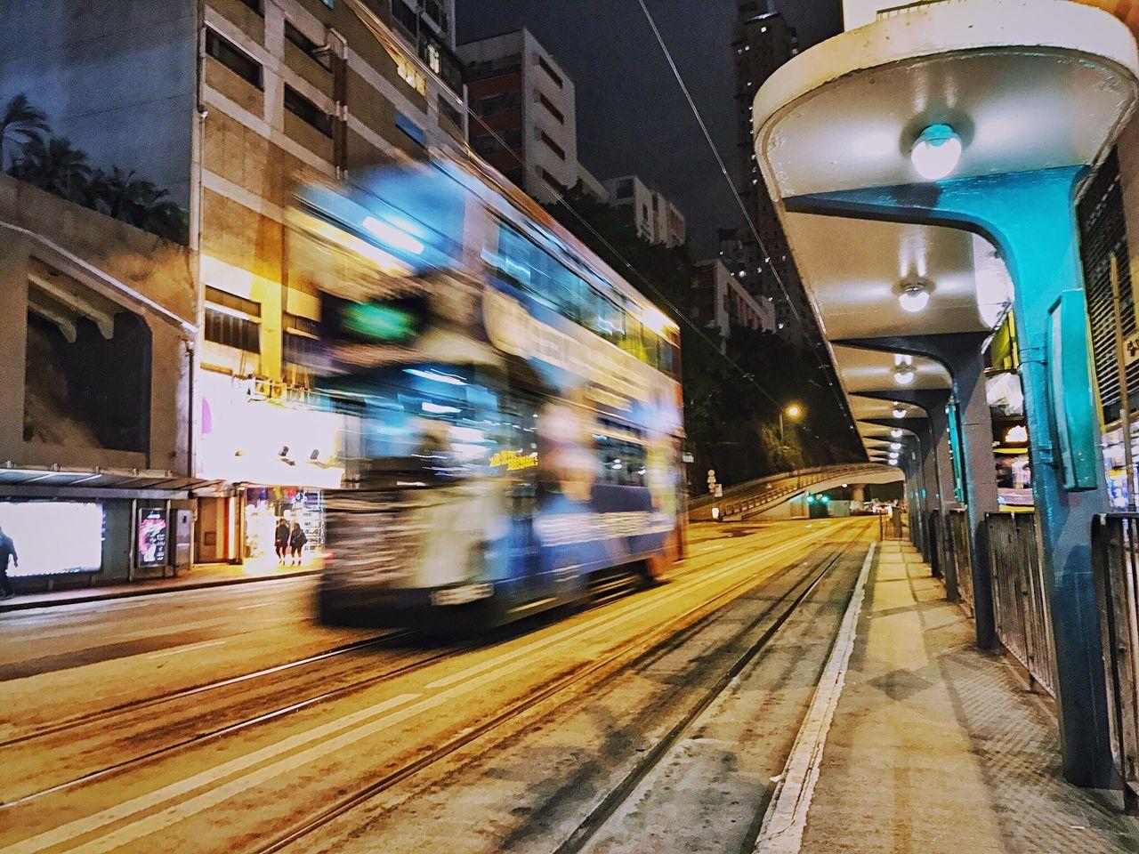 transportation, blurred motion, mode of transport, speed, motion, illuminated, public transportation, built structure, railroad track, rail transportation, night, long exposure, land vehicle, men, outdoors, architecture, sky, people