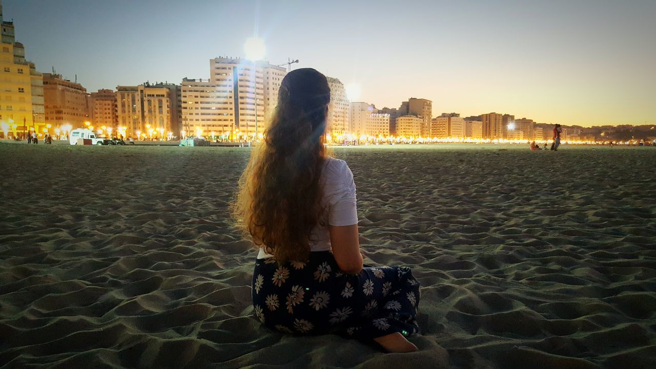 Morocco Tanger  City Night Lights Beach Light And Shadow Beautiful View Loneliness Seated Woman