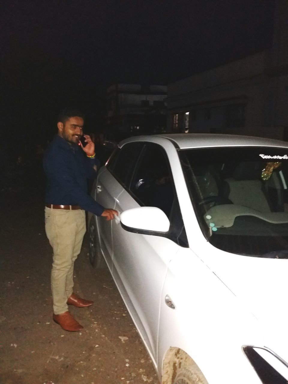 car, transportation, standing, real people, land vehicle, two people, full length, outdoors, night, men, technology, young adult, people