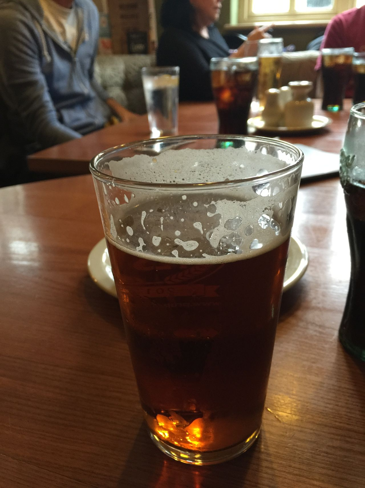 Pint of beer with friends in a pub Beer Drinks Socializing Pub Pint Real Ale