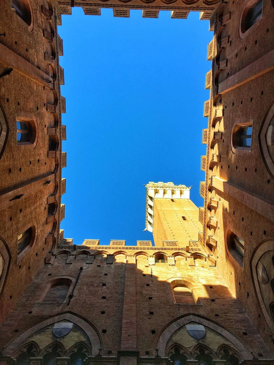 Heads up 😮 Architecture Built Structure Blue Old Ruin Clear Sky Day Sunlight Travel Destinations Sky Siena Siena Tuscany Siena, Italy Piazza Del Campo EyeEmNewHere