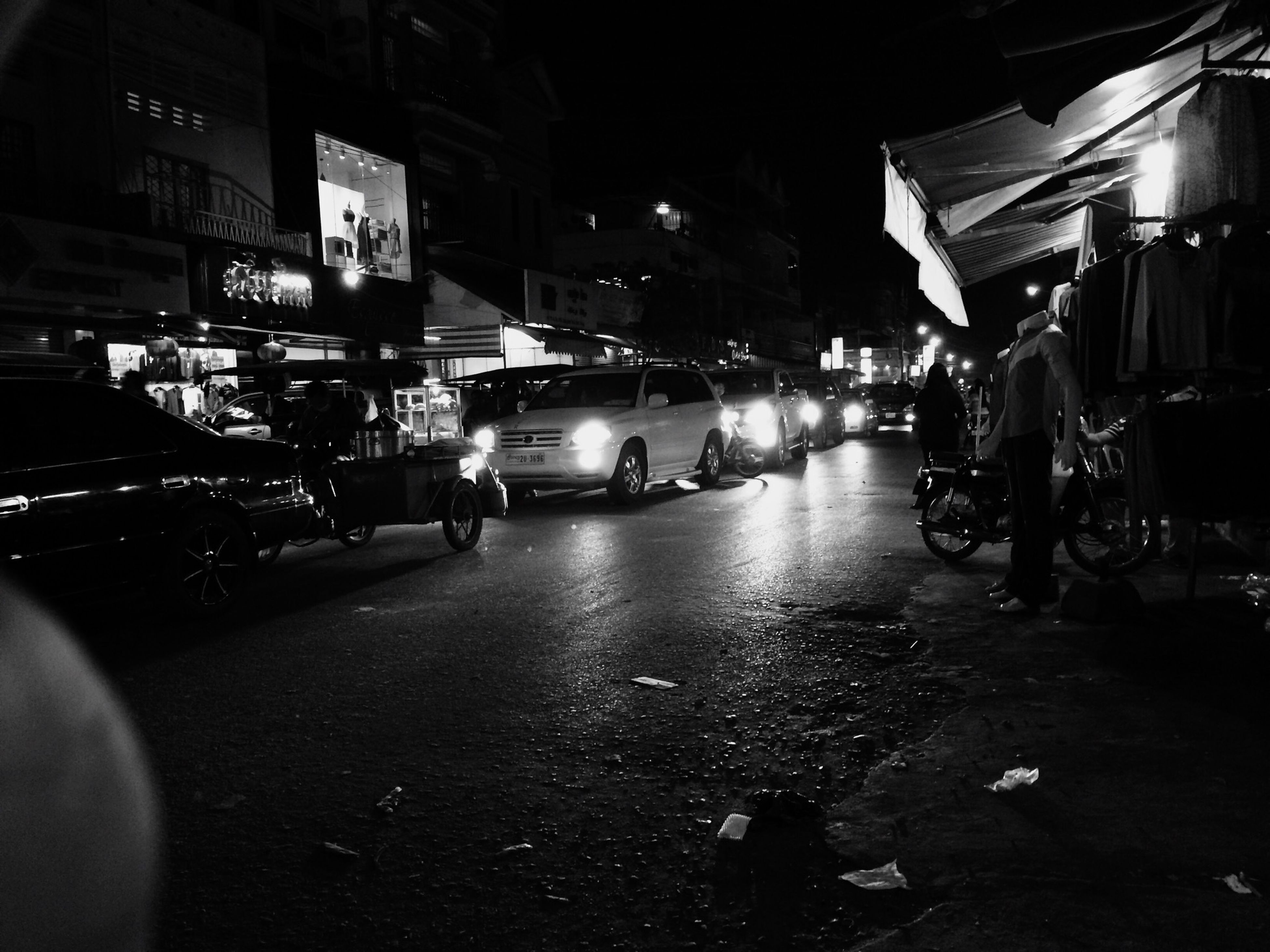 transportation, land vehicle, street, car, mode of transport, building exterior, city, architecture, built structure, city life, city street, men, road, night, incidental people, illuminated, on the move, traffic, person