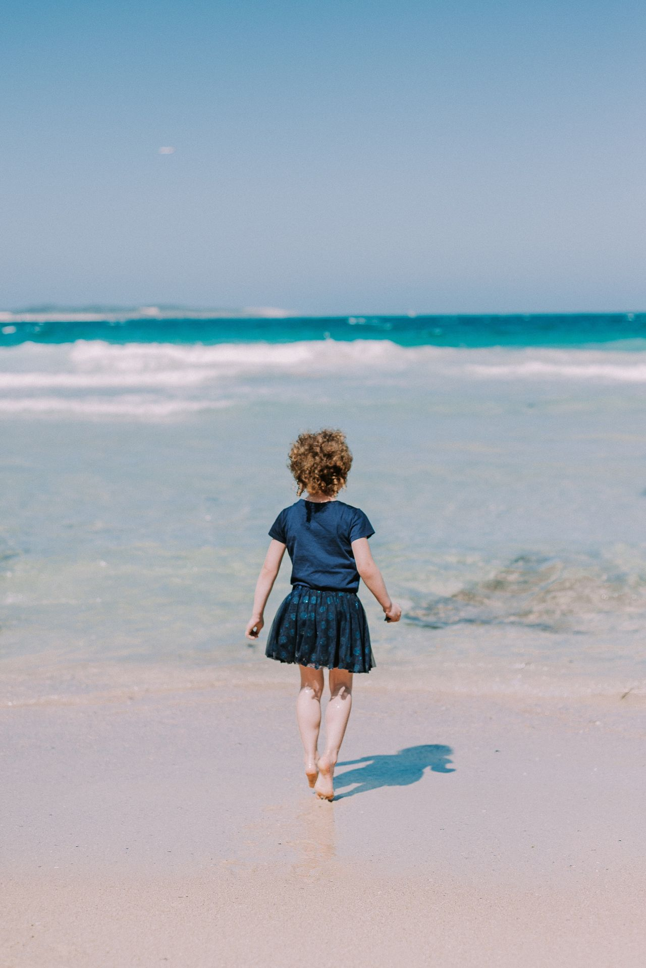 Beach day with my girl Enjoy The New Normal Sea Full Length Beach One Person Rear View Sand Childhood Leisure Activity Real People Lifestyles Outdoors Beauty In Nature Australia EyeEmBestPics EyeEm Best Edits Travel Photography