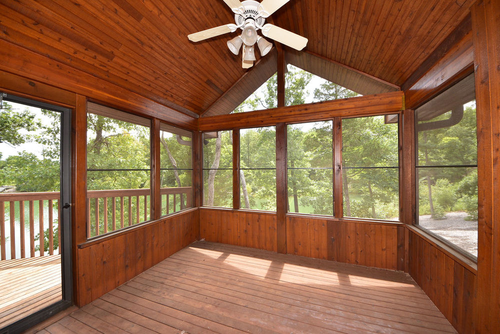 Relaxing screened porch with gorgeous wooded view. Architecture Cathedral Ceiling Day Deck Hardwood Floor Indoors  Lake View Log Cabin No People Outdoors Relaxation Rustic Charm Screened Porch Walkout Window Wood - Material Wood Beams Wood Paneling Wooded View Woods
