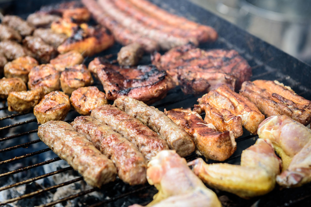 Meat skewer on barbecue grill with coal. Cevapcici, sausages, chicken wings, pork ribs and steak on charcoal barbecue BBQ. Backgrounds Barbecue Barbecue Grill BBQ Cevapcici Chic Close-up Day Food Food And Drink Freshness Grilled Heat - Temperature Hot Making Music Meat No People Outdoors Picknik Preparing Food Sausage Stem Sunset Wing Wings