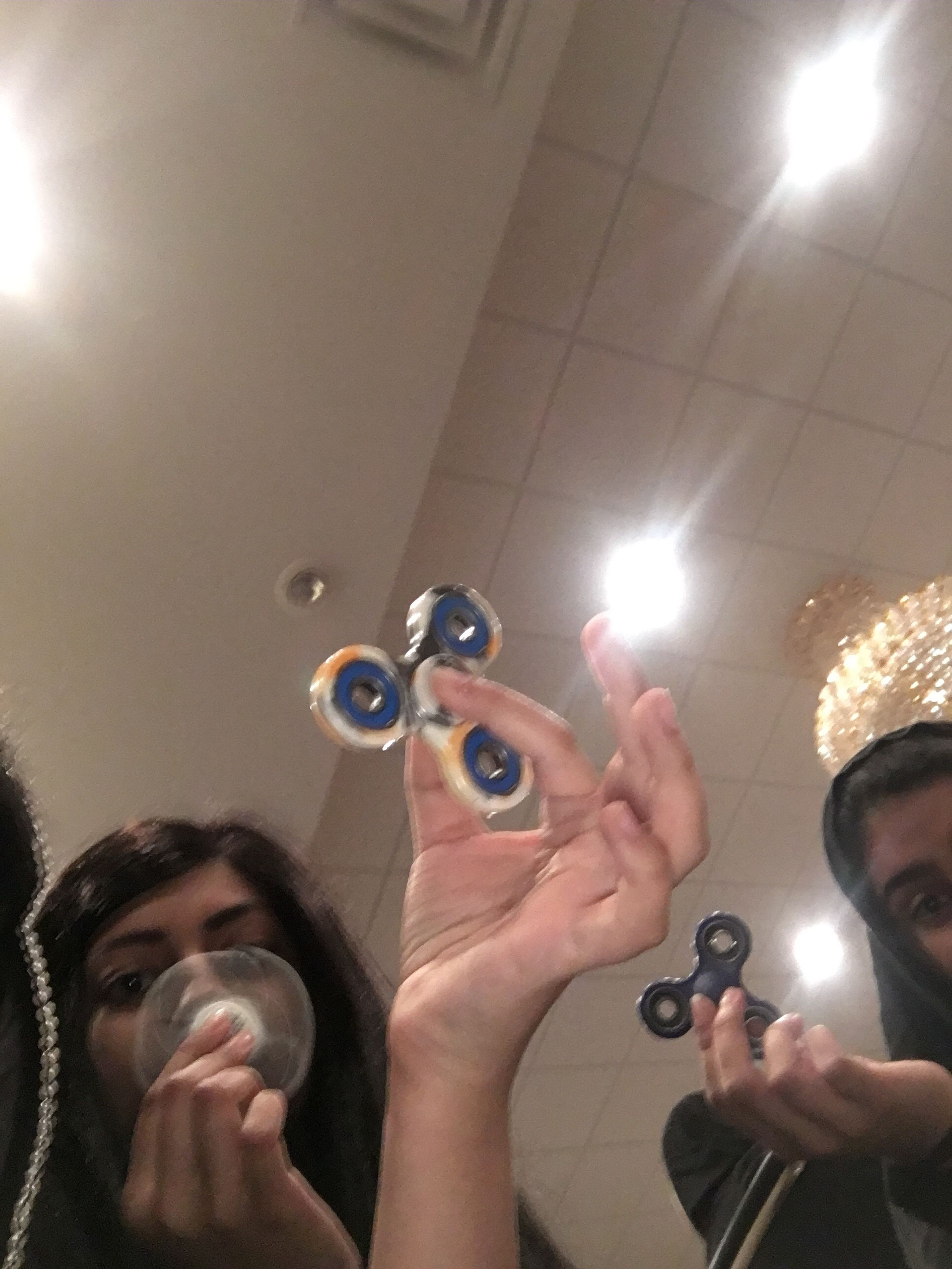 real people, blowing, leisure activity, holding, young adult, young men, bubble wand, indoors, lifestyles, bubble, young women, low angle view, headshot, togetherness, men, technology, day