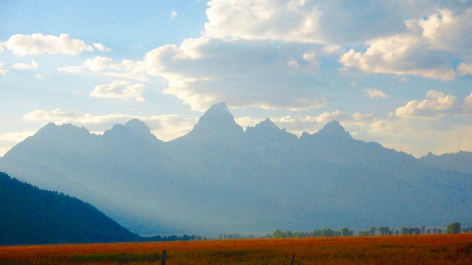 Agriculture Beauty In Nature Cloud - Sky Day Farm Field Geology Grand Tetons National Park Landscape Majestic Mountain Mountain Peak Mountain Range Nature No People Non-urban Scene Outdoors Physical Geography Remote Rocky Rural Scene Scenics Sky Tranquil Scene Tranquility