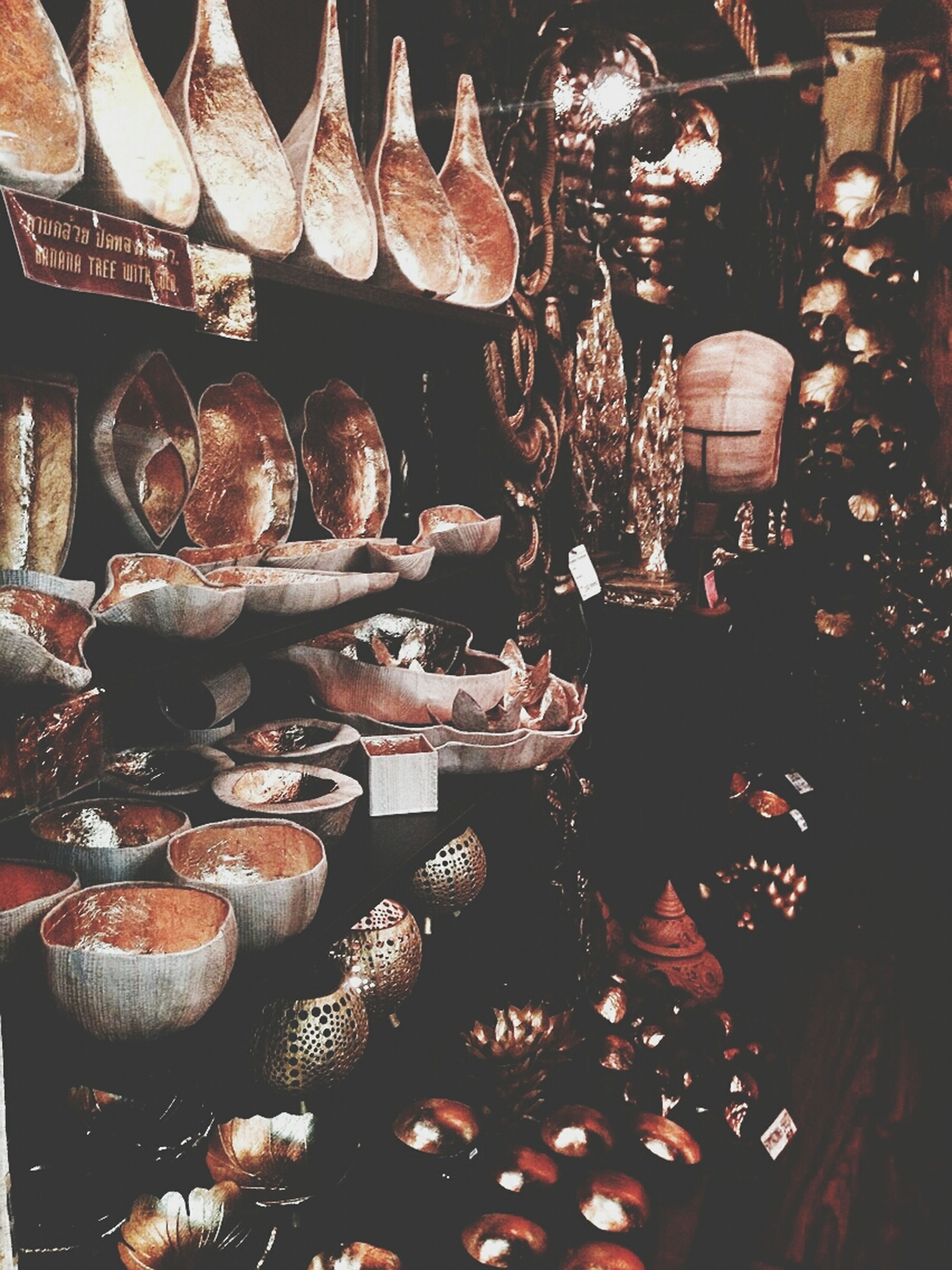 large group of objects, abundance, high angle view, variation, arrangement, for sale, indoors, retail, wood - material, choice, no people, still life, freshness, market, stack, close-up, market stall, in a row, group of objects