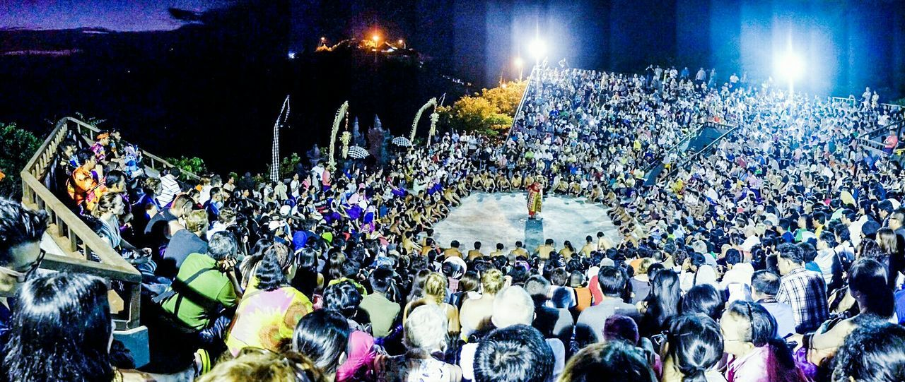 large group of people, crowd, real people, high angle view, music, night, togetherness, audience, men, illuminated, performance, popular music concert, outdoors, people, adult, adults only