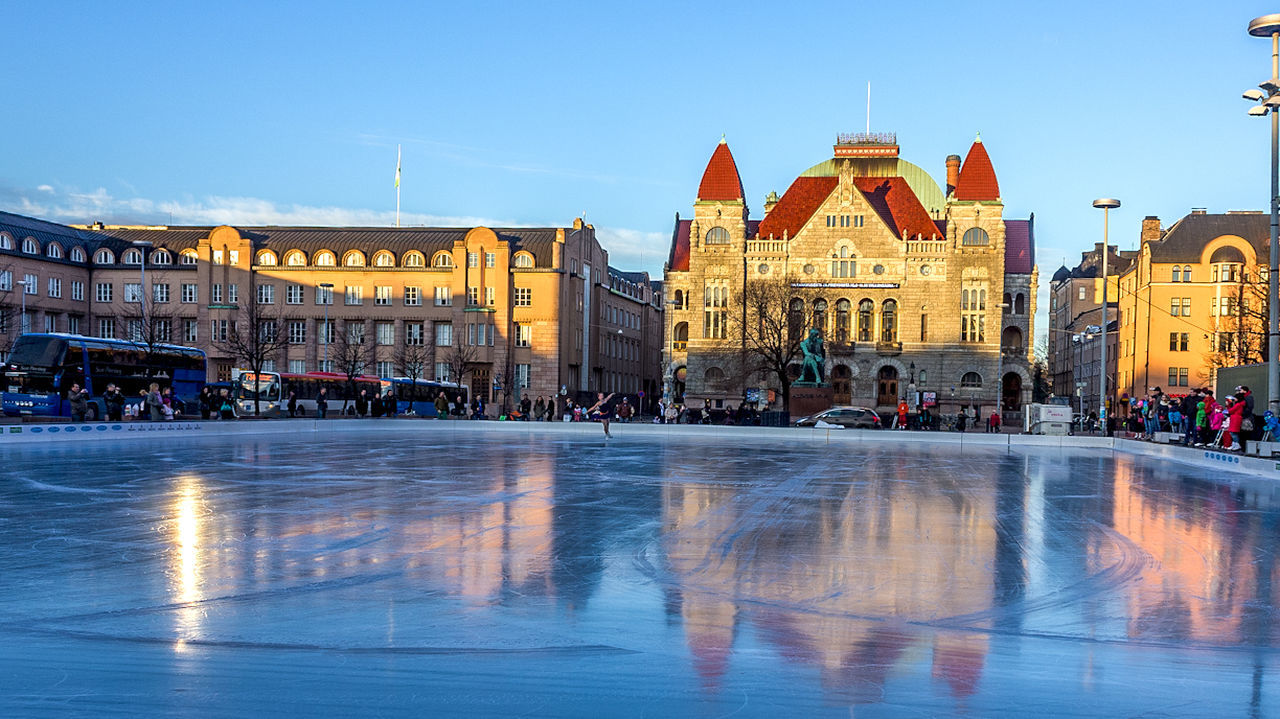 architecture, building exterior, built structure, large group of people, religion, spirituality, place of worship, sky, real people, blue, outdoors, day, water, ice rink, city, clear sky, people