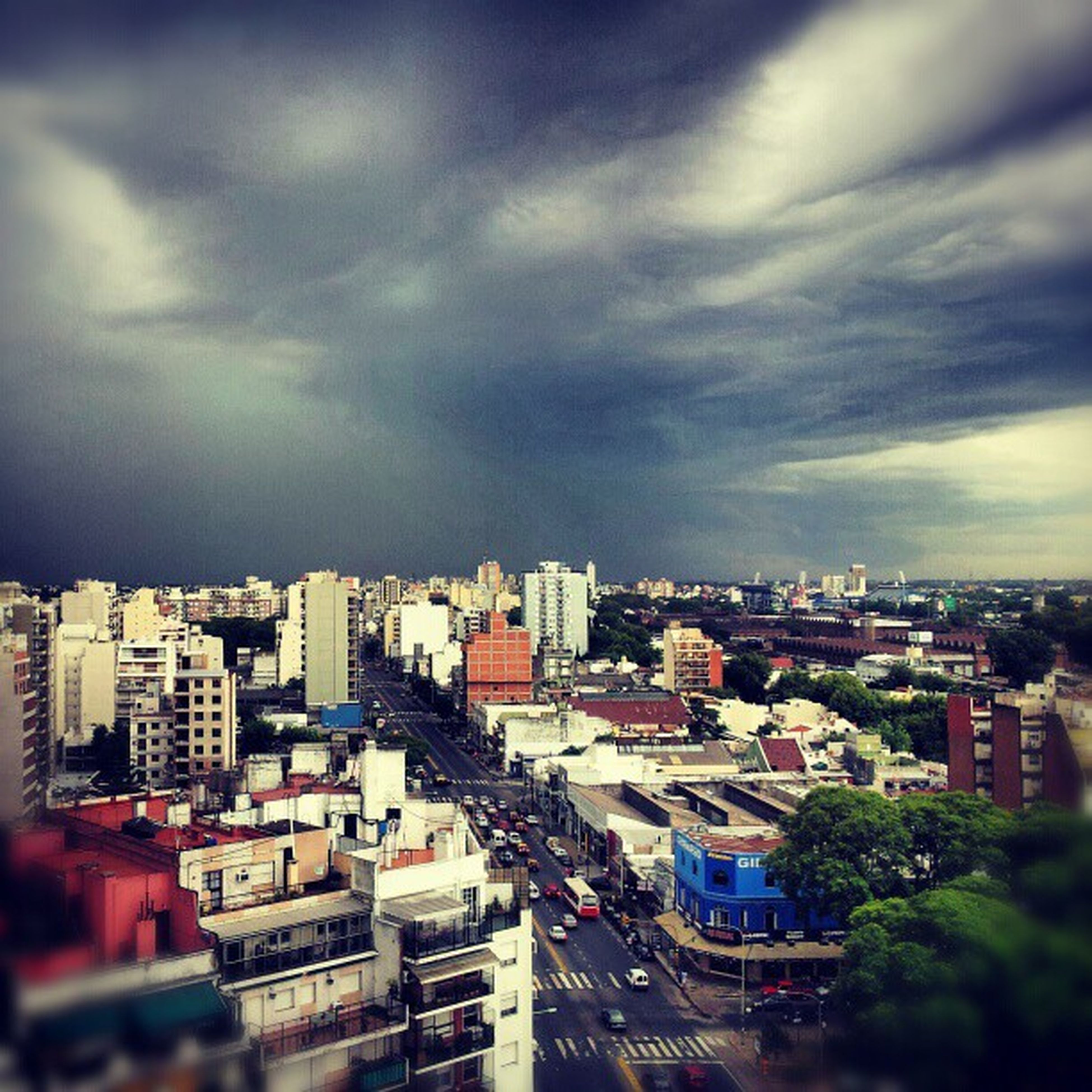 building exterior, architecture, built structure, city, cityscape, sky, cloud - sky, high angle view, cloudy, residential district, crowded, residential building, residential structure, cloud, city life, overcast, outdoors, weather, tree, no people
