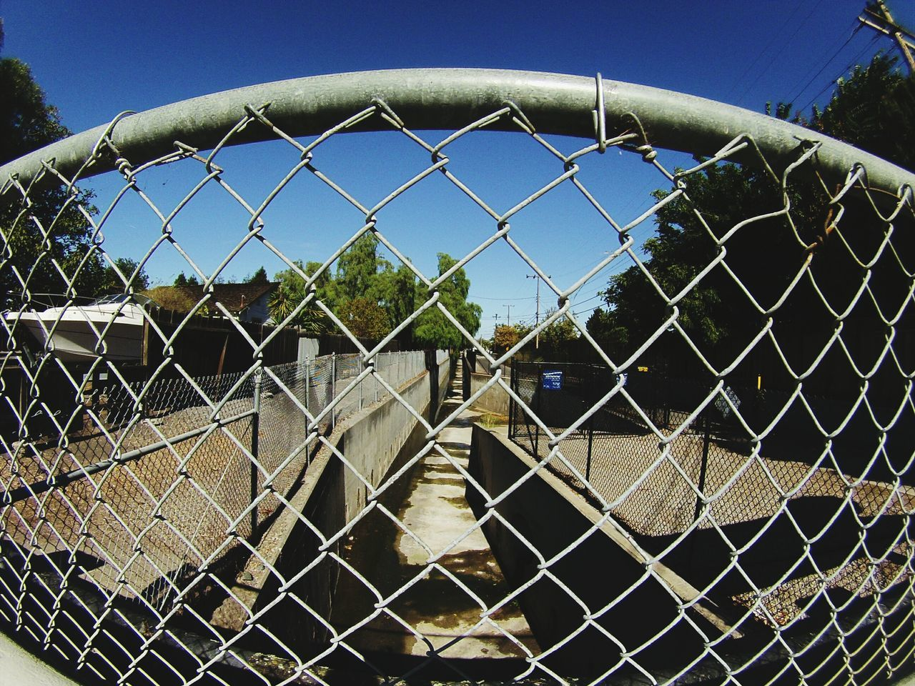 chainlink fence, metal, protection, safety, day, security, outdoors, no people, architecture, building exterior, city, clear sky, sky, close-up
